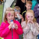Children with recycled noise makers called tooteroos